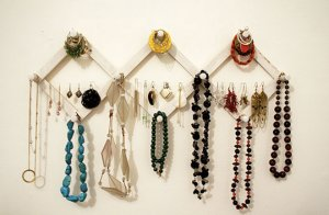 Think outside the box 3 creative ways to store your for Ways to hang hats on wall